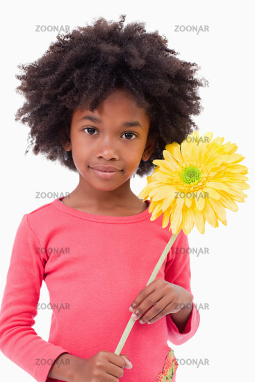 Portrait of a girl holding a flower