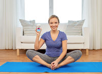 woman with smartphone having online yoga class