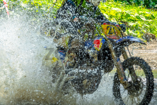 Motorcycle Enduro and Lots of Water Spray
