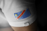 Patch of the national flag of the Democratic Republic of the Congo on a white t-shirt