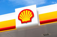 Shell gas station signboard against the blue sky