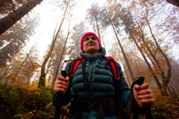 Active woman hiking in beautiful fall forest