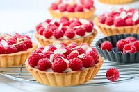 Tartlets with custard and raspberries.