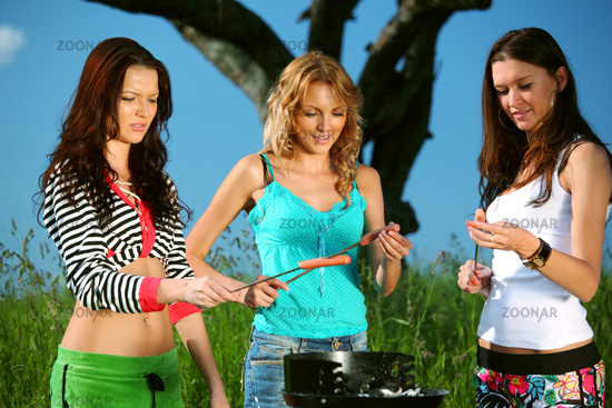 very fun girlfriends on picnic cook