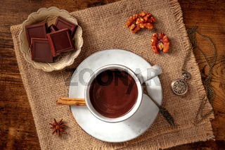 Hot chocolate, overhead flat lay shot with spices