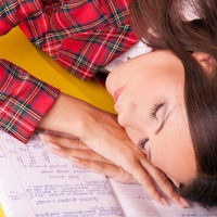 Closeup of beautiful girl sleep on the notebook. S