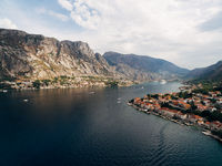 Kotor Bay, photo from a drone, near the city of Prchan. View of the town Dobrota and Kotor, and the rocky mountains above them.