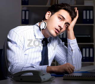 Tired and exhausted helpdesk operator during night shift