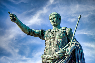 The roman emperor Gaius Julius Caesar statue in Rome, Italy. Concept for authority, domination, leadership and guidance.