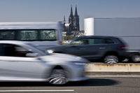 Lots of traffic on the Zoobruecke with the cathedral in the background, Cologne, Germany, Europe