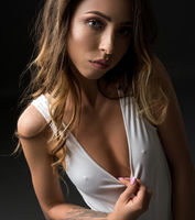 Seductive woman in white top looking at camera