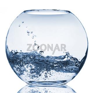 water splash in glass aquarium isolated on white