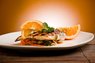 Grilled chicken breast on ratatouille bed