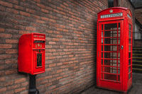 The traditional British public red mailbox and telephone kiosk or booth
