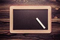White chalk abstract on vintage slate blackboard on wooden background
