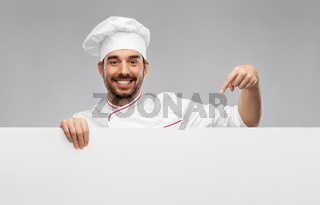 happy smiling male chef with big white board