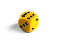 Yellow dice isolated on white background