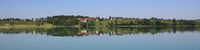 Idyllic rural landscape reflecting in Lake Pfaffikon, Pfaeffikon. Old village Seegraben,