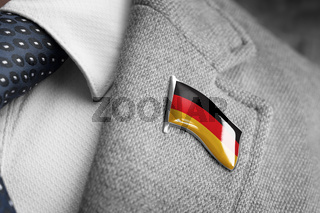 Metal badge with the flag of Germany on a suit lapel