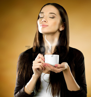 Woman with coffee cup on a brown background.