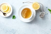 Lemon tea in a cup, shot from above with a place for text. Healthy organic detox