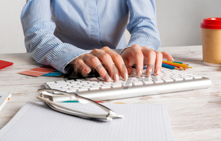 Woman consultant typing on keyboard