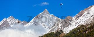 Paraglider over Swiss Alps, Switzerland