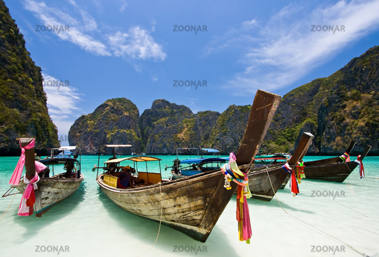 Boats on white sand beach