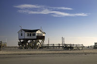 Pile dwellings in the mudflats at low tide, Sankt Peter-Ording, North Sea, Germany, Europe