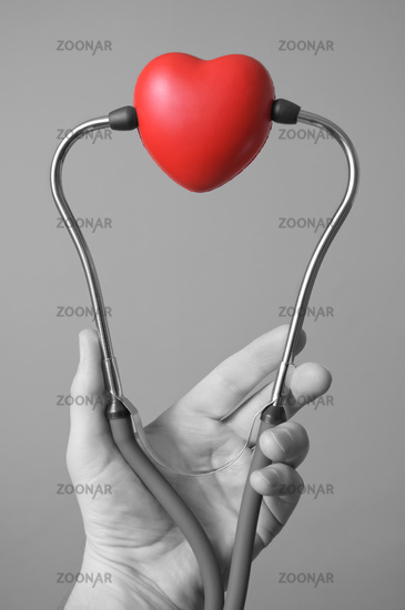 Hand with stethoscope and a heart