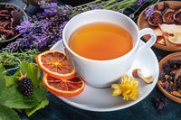 Organic tea. Herbs, flowers and fruit around a cup of tea