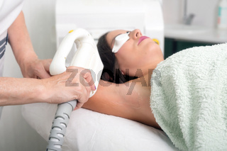 Laser epilation and cosmetology in beauty salon. Cosmetology, spa and hair removal concept.
