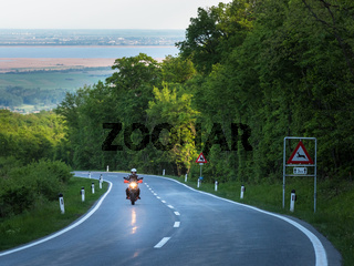 Motorcyclist driving on a rural road