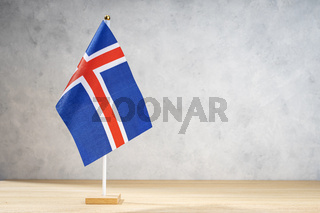 Iceland table flag on white textured wall. Copy space for text, designs or drawings