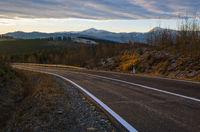 Asphalt road curve and autumn sunset Mountains, Ukraine, Carpathian.