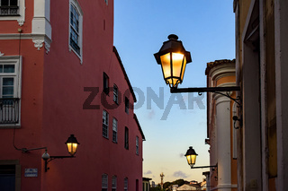 Old iluminated metal lanterns and facade of a colonial houses in the historic Pelourinho district