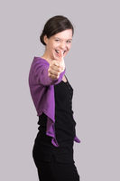Young woman with gesture of motivation