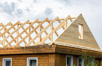 Construction new triangular roof of a wooden house