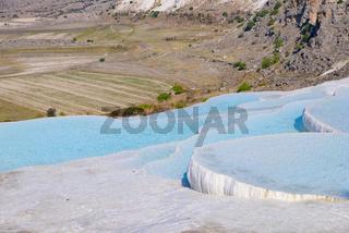 Travertine terrace formations and pools at Pamukkale (cotton castle), Denizli, Turkey