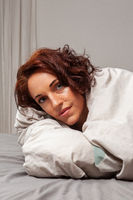 Woman cuddling in bed