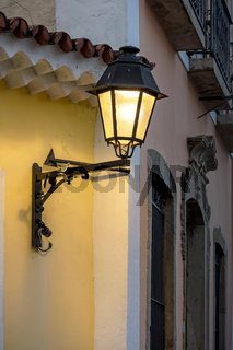 Old metal lanterns and colorful facade of a colonial house in the historic Pelourinho district