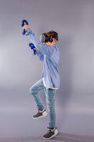 Teenager boy using the virtual reality glasses