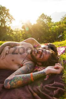 couple relaxing in meadow