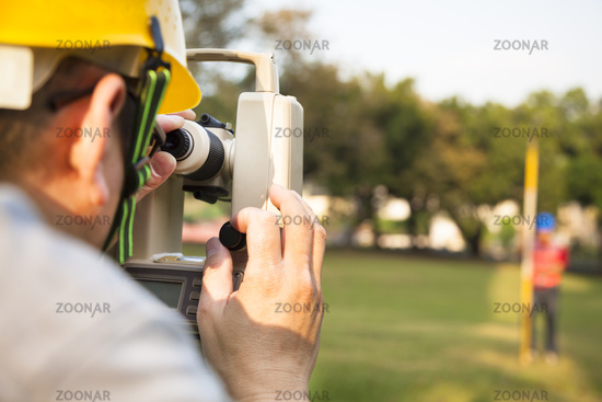Surveyor engineer with partner making measure on t