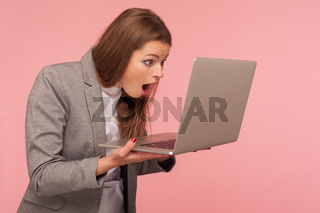 Emotional young woman in jacket on pink background.