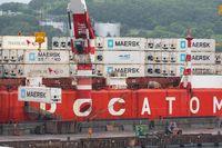 Crane unloaded container cargo ship Sevmorput Rosatomflot - Russian nuclear-powered icebreaker lighter aboard ship carrier