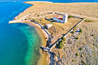 Stone desert island of Zecevo church and pilgrimage aerial view