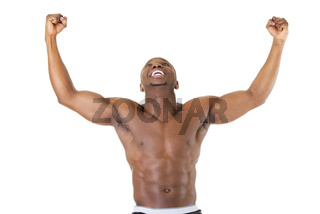 Well-built muscular black man with arms raised