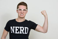 Portrait of young handsome nerd man with eyeglasses