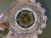 A circle shaped building resident housing aerial drone view.